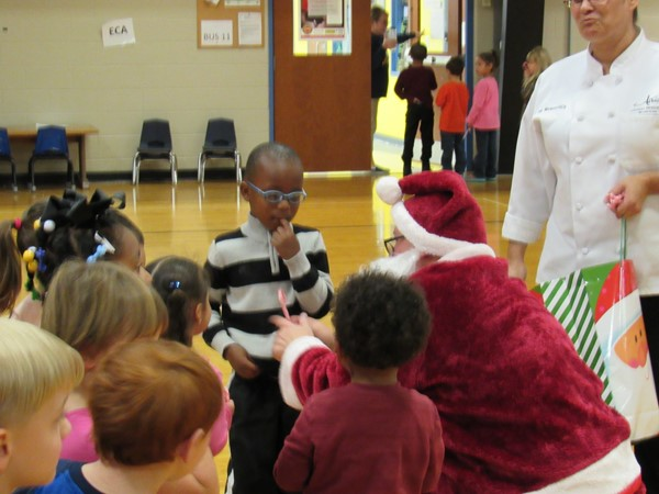 Santa handing out candy canes.