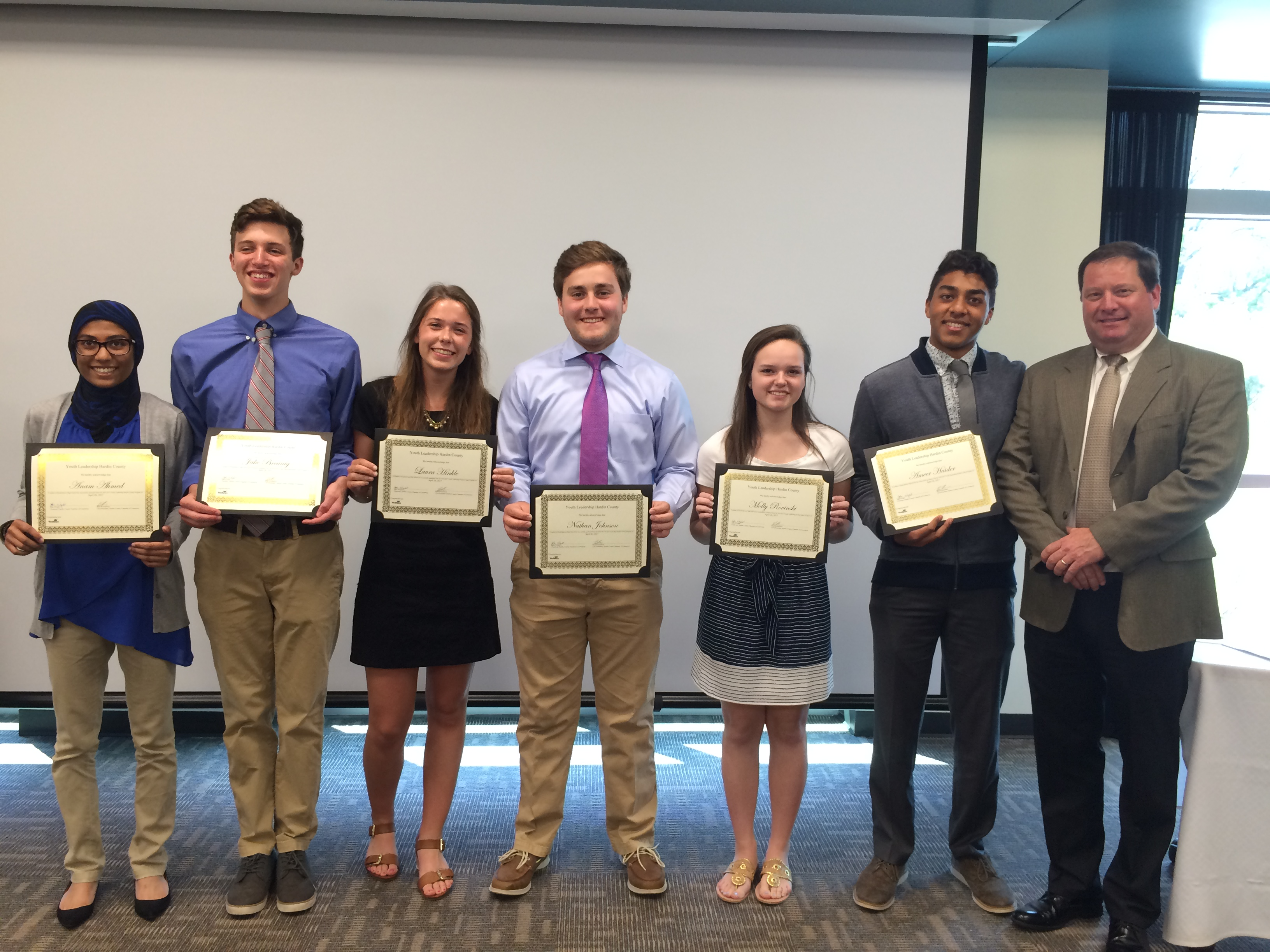 Mr. Jon Ballard, Superintendent, with EHS top honor students.
