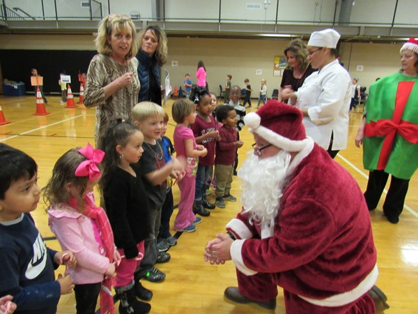 Santa talking with Panther Academy students.