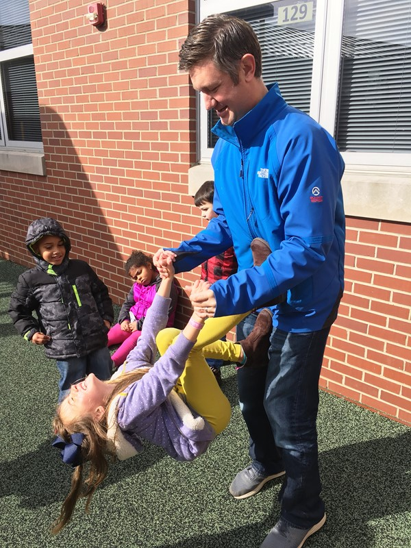 Dr. Lye at play with daughter at recess.