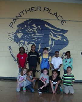 Panther Place logo and students
